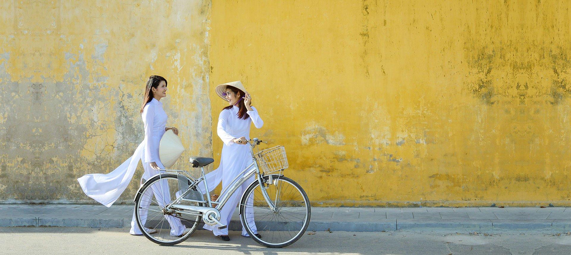 Vietnamese women in traditional clothes ao dai